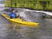 Sea kayak on the falls of Lora flood tide _Ken Lacey
